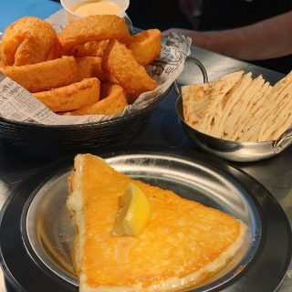 Start off with our beer battered onions rings and Saganaki!