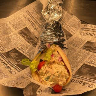 Smoked Turkey Salad Gyro Tossed in a smoked jalapeño mayo with fresh cilantro, lettuce, tomatoes, & onions $10
